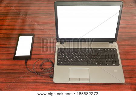 Tablet Connected To Computer. Data Transfer.