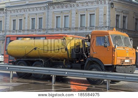 Nizhny Novgorod, Russia April 11, 2017: Auto appliances communal services of the city. KAMAZ trucks with a capacity for water purification and cleaning of curbs, bumpers,  the city. Close-up. Russia.
