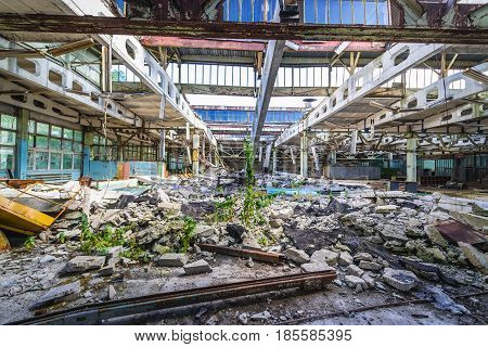Main hall of former factory in Pripyat desolate city in Chernobyl Exclusion Zone Ukraine