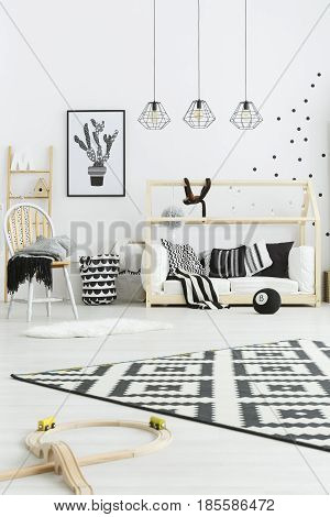 Spacious black and white room designed for kid