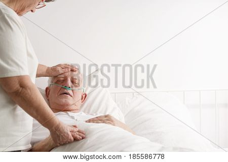 Wife Supporting Ill Elderly Husband