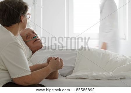 Sick Man Holding Wife's Hands