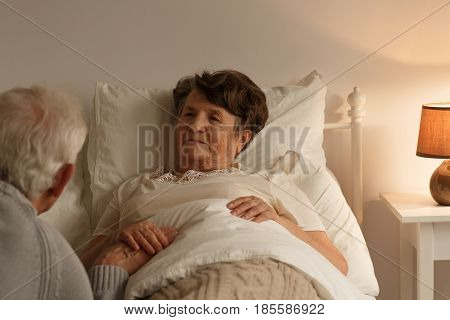 Husband Holding Sick Wife's Hand
