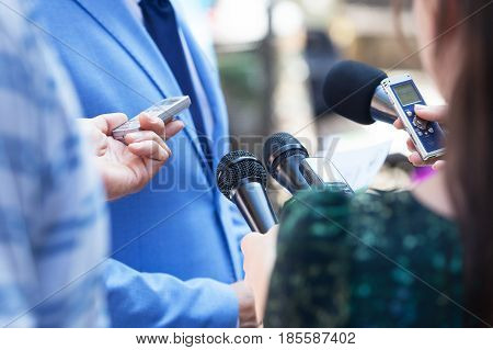 Journalists making media interview with business person or politician. Press conference. Journalism.