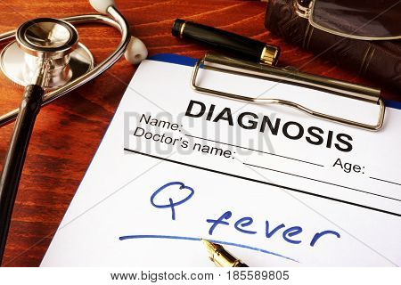 Medical form with diagnosis Q fever on a table.