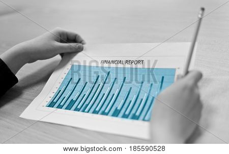 Businesswoman With Financial Reports