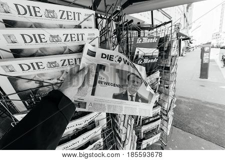 PARIS FRANCE - MAY 9 2017: Pov buying Die Welt newspaper front page with the picture of the newly elected French president Emmanuel Macron after the second round French Presidential election