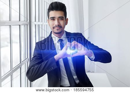 Young Businessman In Love Shows Heart Sign