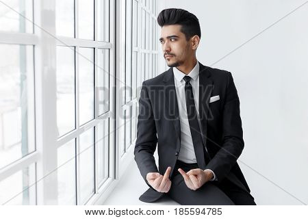 Young Businessman Shows Fuck You Off Sign
