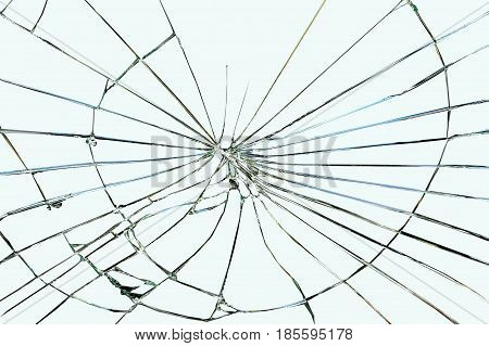 Broken window glass on a grayish-blue background