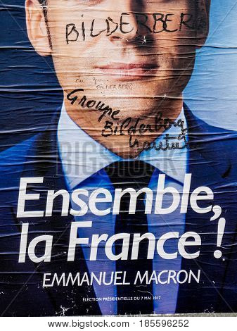 PARIS FRANCE - MAY 9 2017: Detail of the Emmanuel Macron portrait poster next to polling place after the second round French presidential election marker inscription Member of Bilderberg group