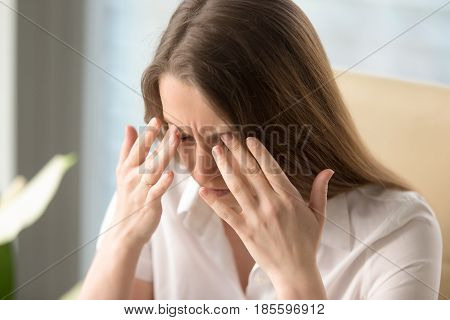 Businesswoman has painful spasm in head. Female feeling dizziness and loses consciousness. Fluctuations of blood pressure, hypertensive crisis symptoms. Headache because of critical overwork at work