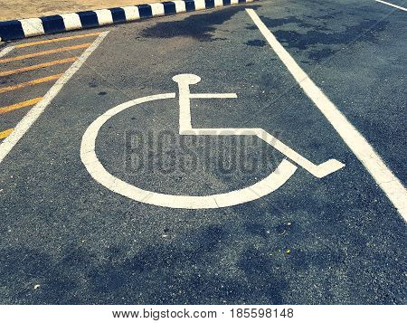 Close up parking space reserved for handicapped person,Handicapped Parking Spaces in commercial parking lot