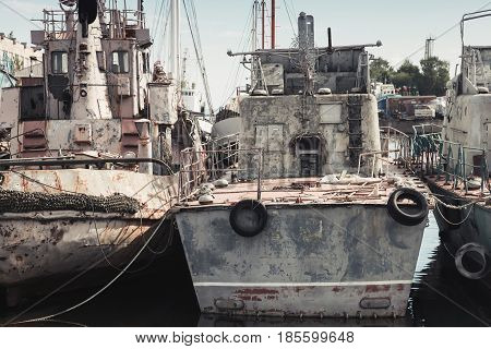 Old Rusted Gray Industrial Ships, Stern View