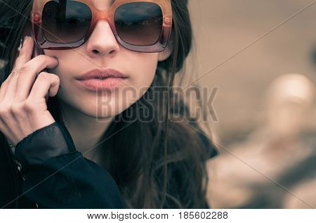 Pretty Woman In Stylish, Fashionable, Vintage Brown Sunglasses