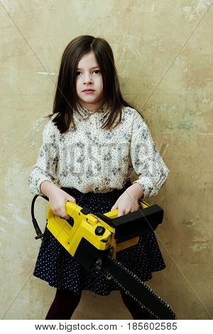 Cute Girl Builder Holding Portable Yellow Saw Or Chainsaw