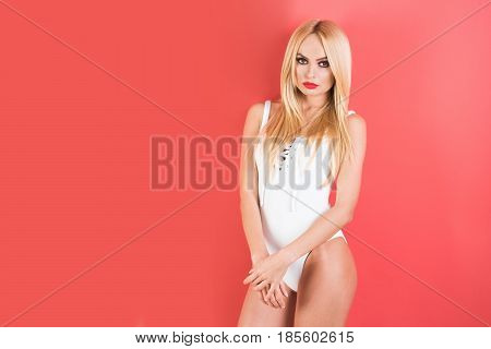 Blonde Woman With Red Lips In Fitness Bodysuit