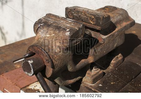 Old iron rusty grunge vintage heavy duty vise closeup