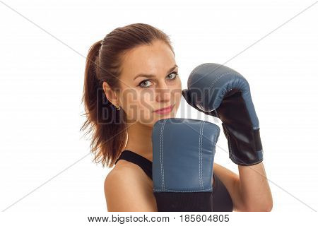 Portrait of a charming young girl in boxing gloves close-up isolated on white background