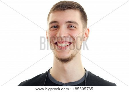 young handsome guy is cheerful smiles on camera close-up isolated on white background