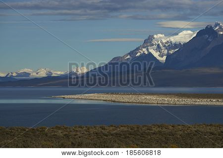 Peaks of Torres del Paine towering over the waters of  Lago Sarmiento in Torres del Paine National Park in southern Chile