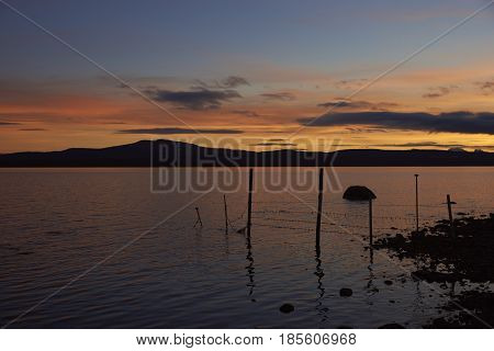 Sunset over the sea and mountains of Patagonia at Puerto Natales in southern Chile