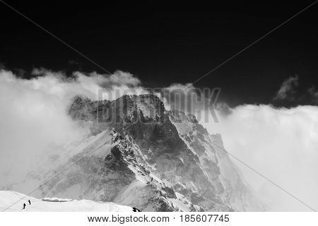 Black And White View On Snow Mountains In Clouds