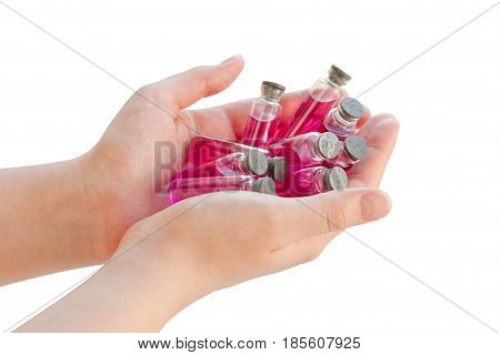 Ampoule In Woman Hand Isolated On White Background