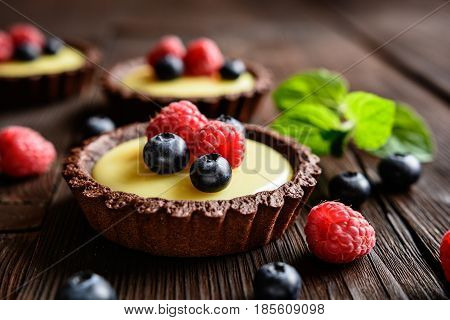Tartlets With Vanilla Pudding, Blueberry And Raspberry