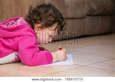 Cute Little Young Toddler Coloring on Paper