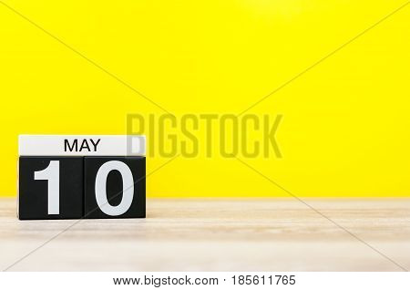 May 10th. Day 10 of month, calendar on yellow background. Spring time, empty space for text. International or World Press Freedom Day.