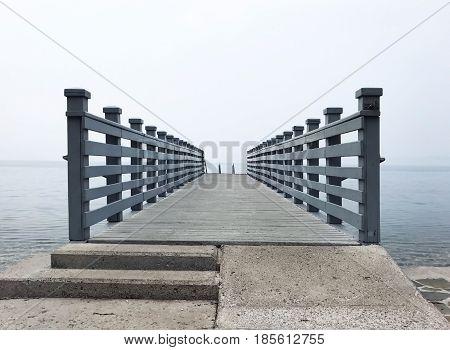 mobile photo pier to horizon grey weather adriatic sea