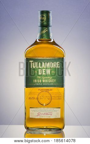 Tullamore Dew whiskey on gradient background. Tullamore Dew is blended Irish whiskey produced by William Grant and Sons since 1829.