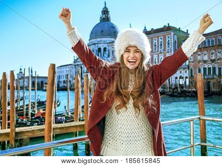 Smiling Tourist Woman On Embankment In Venice, Italy Rejoicing