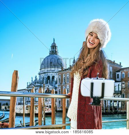 Tourist Woman In Venice, Italy Taking Selfie Using Selfie Stick