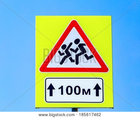 Road sign Warning Children on blue sky background