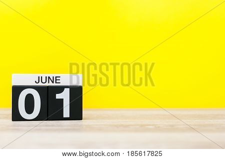 June 1st. Day 1 of month, calendar on yellow background. First summer day. Empty space for text. Happy Childrens Day.
