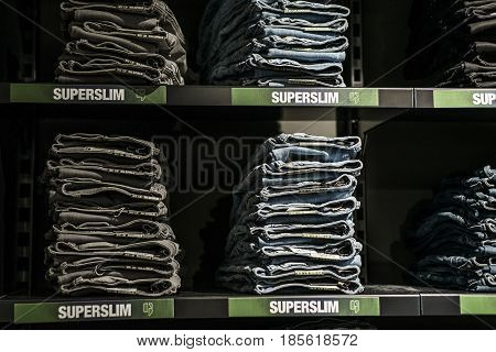 Roermond, Netherlands 07.05.2017 - Stack of blue Jeans at the Diesel Store in the Mc Arthur Glen Designer Outlet shopping area