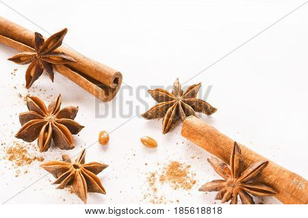 anise stars with cinnamon stick over white background copy space