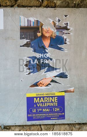 Election posters of candidates for the French presidential election in Paris, France,8 May, 2017. - 8 May, 2017, France, Paris.Election poster on the wall in Paris, France.