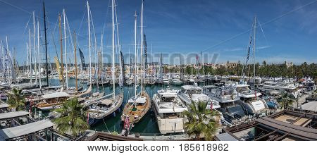 Valencia, Palma de Mallorca - May 2, 2017: XXXIV Edition of the International Boat Show in Palma. Top view of many sailboats and luxury yachts exhibited at the fair. Balearic Islands, Mediterranean Sea.
