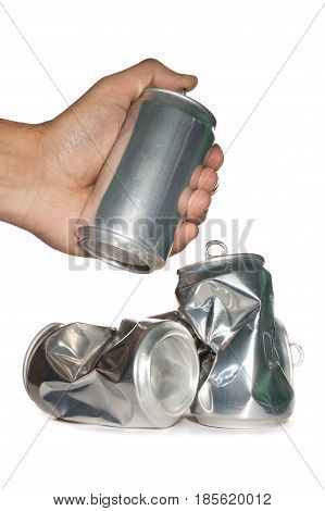 hand with dented cans on white background