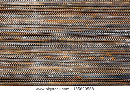 Thick rusty reinforcing bar metal, pattern, texture.