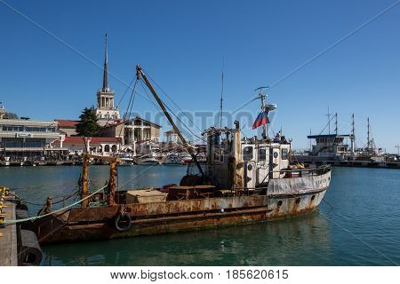 Sochi Russia - April 27 2017: Old ship on the background of a seaport in the central region of Sochi Krasnodar Territory Russia.
