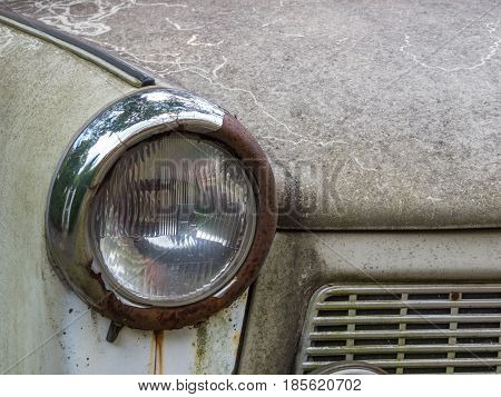 Berlin Germany - August 23 2014: Headlight of a rusted old Trabant well known model in the former German Democratic Republic