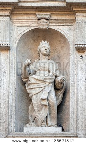 ROME, ITALY - SEPTEMBER 02: Saint Clotilde queen of the Franks statue on the facade of Chiesa di San Luigi dei Francesi - Church of St Louis of the French, Rome, Italy on September 02, 2016.