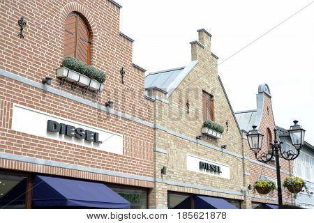 Roermond, Netherlands 07.05.2017 - Logo of the Diesel jeans Store in the Mc Arthur Glen Designer Outlet shopping area