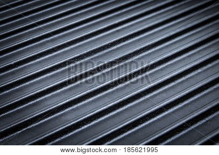 Cast iron corrugated griddle pan. Surface of new metal grill texture