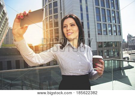 Business Selfie. Portrait Of Beautiful Business Woman In Formal Wear Taking A Selfie While Drinking