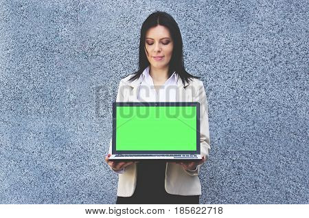 Technologies For Business. Portrait Of Confident Business Woman In Formal Wear Is Keeping Laptop Wit